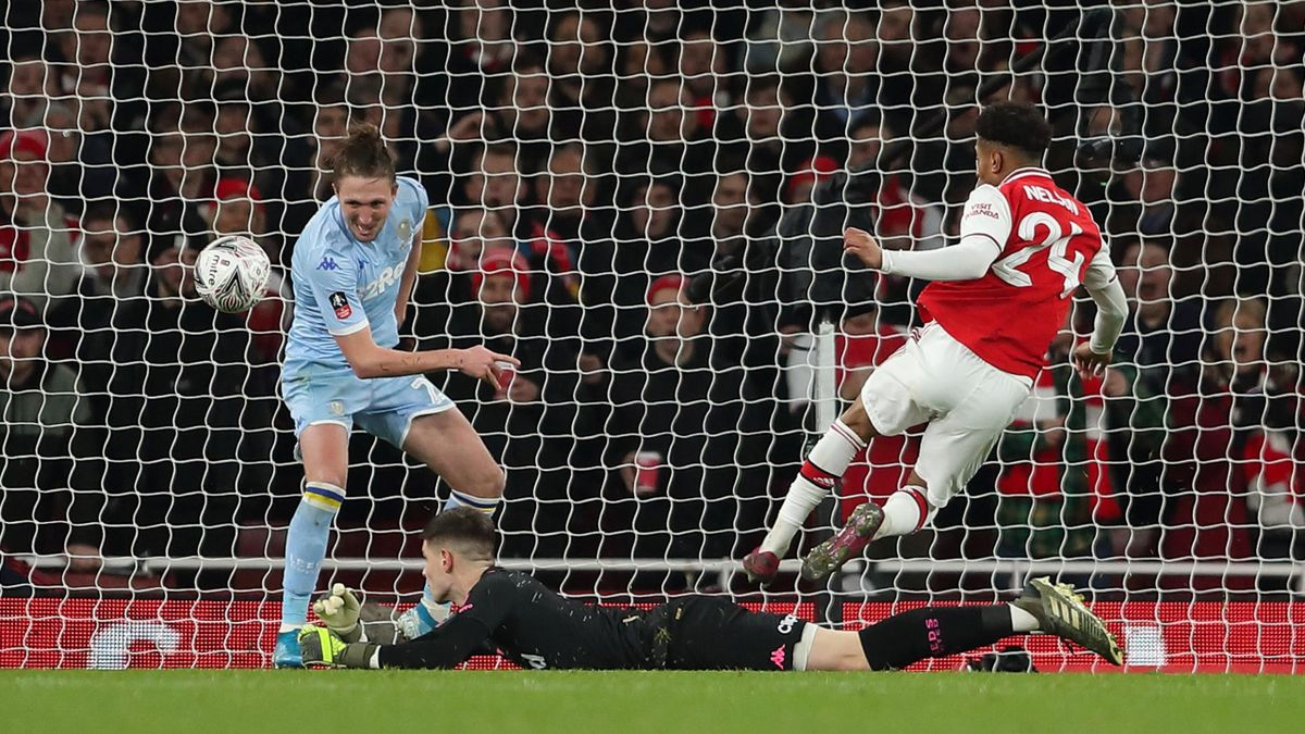 Reiss Nelson of Arsenal scores a goal to make it 1-0 during the FA Cup Third Round match between Arsenal and Leeds United at Emirates Stadium on January 6, 2020