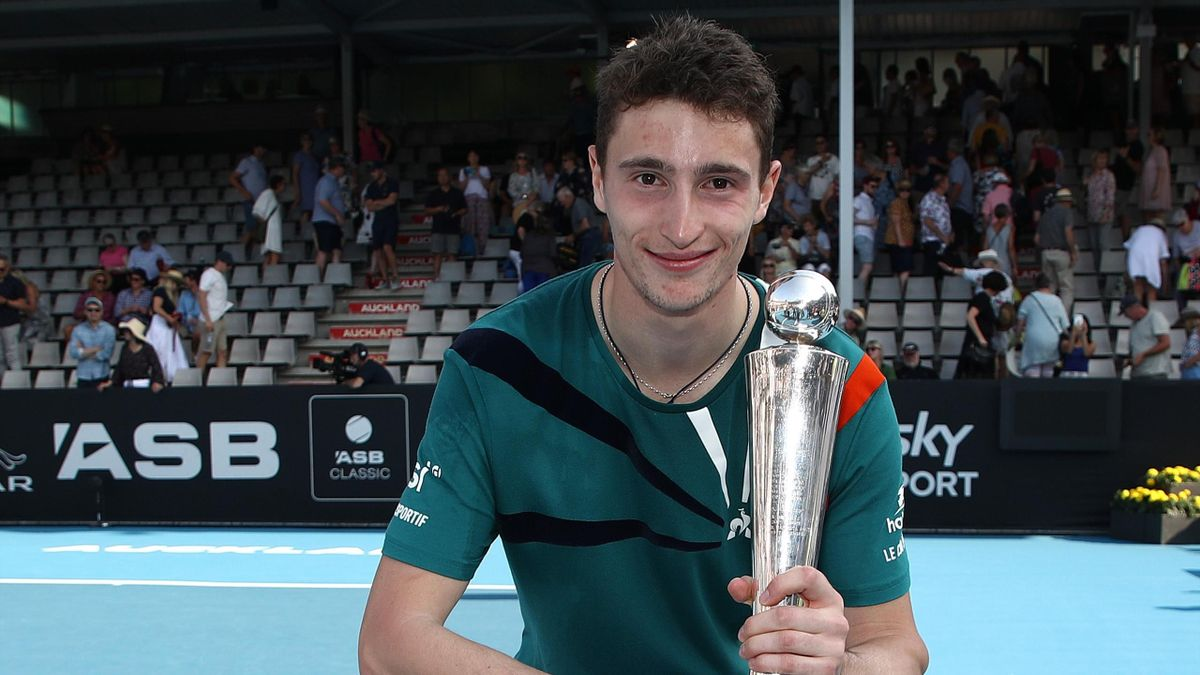 Ugo Humbert of France holds up the trophy after winning the mens singles final against Benoit Paire of France on day six of the 2020 ASB Classic at the ASB Tennis Centre at ASB Tennis Centre on January 18, 2020 in Auckland