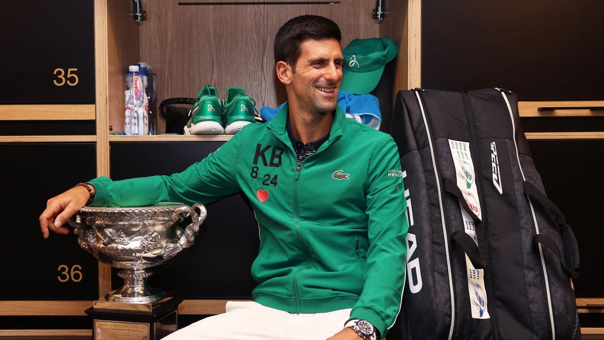 Novak Djokovic of Serbia poses with the Norman Brookes Challenge Cup in the locker room after winning the Men's Singles Final against Dominic Thiem of Austria on day fourteen of the 2020 Australian Open at Melbourne Park on February 03, 2020 in Melbourne,