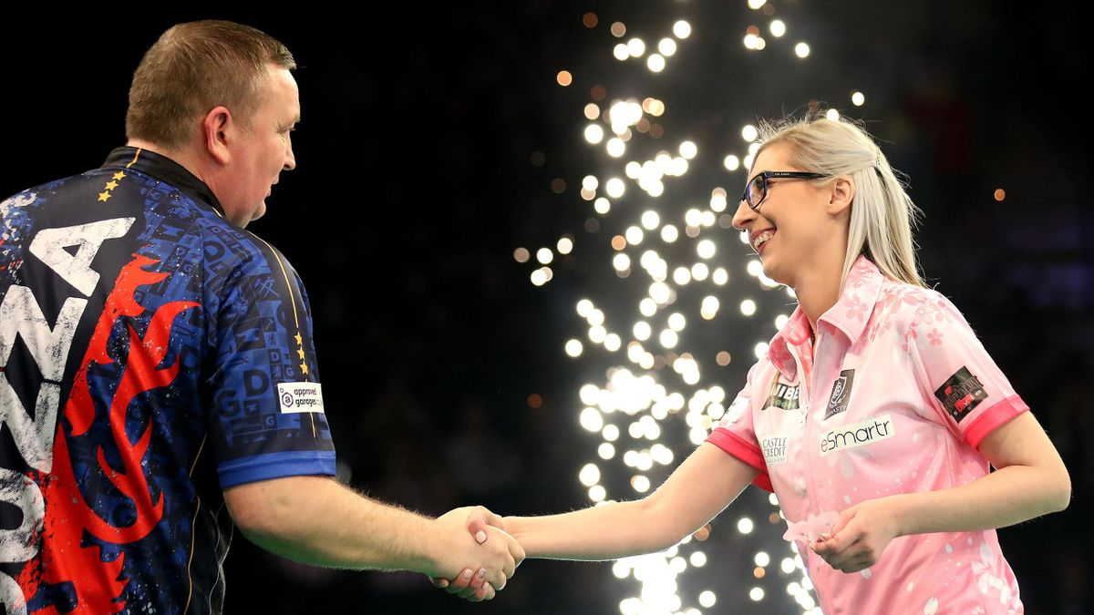 Fallon Sherrock shakes hands with opponent Glenn Durrant following their draw during day two of the Unibet Premier League at Motorpoint Arena on February 13, 2020 in Nottingham, England