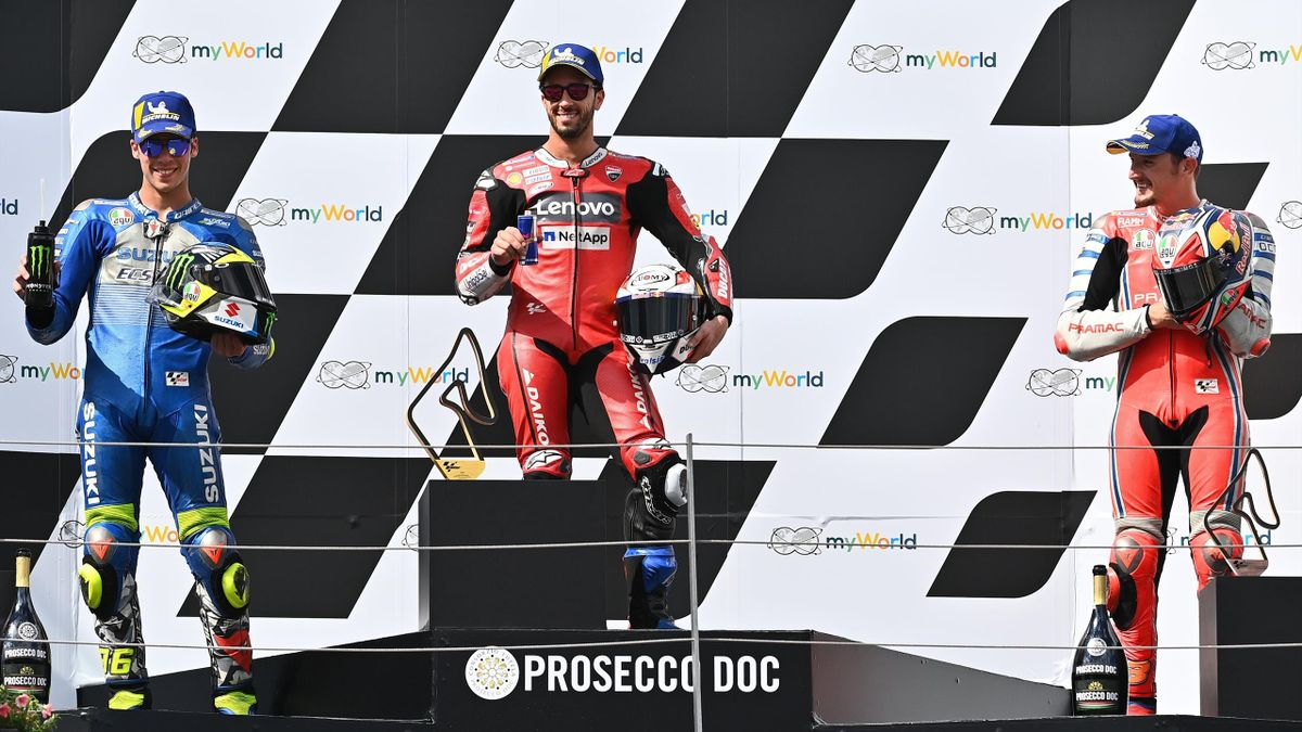 Ducati's Italian rider Andrea Dovizioso (C), second placed Suzuki Ecstar's Spanish rider Joan Mir (L) and third placed Pramac Racing's Australian rider Jack Miller