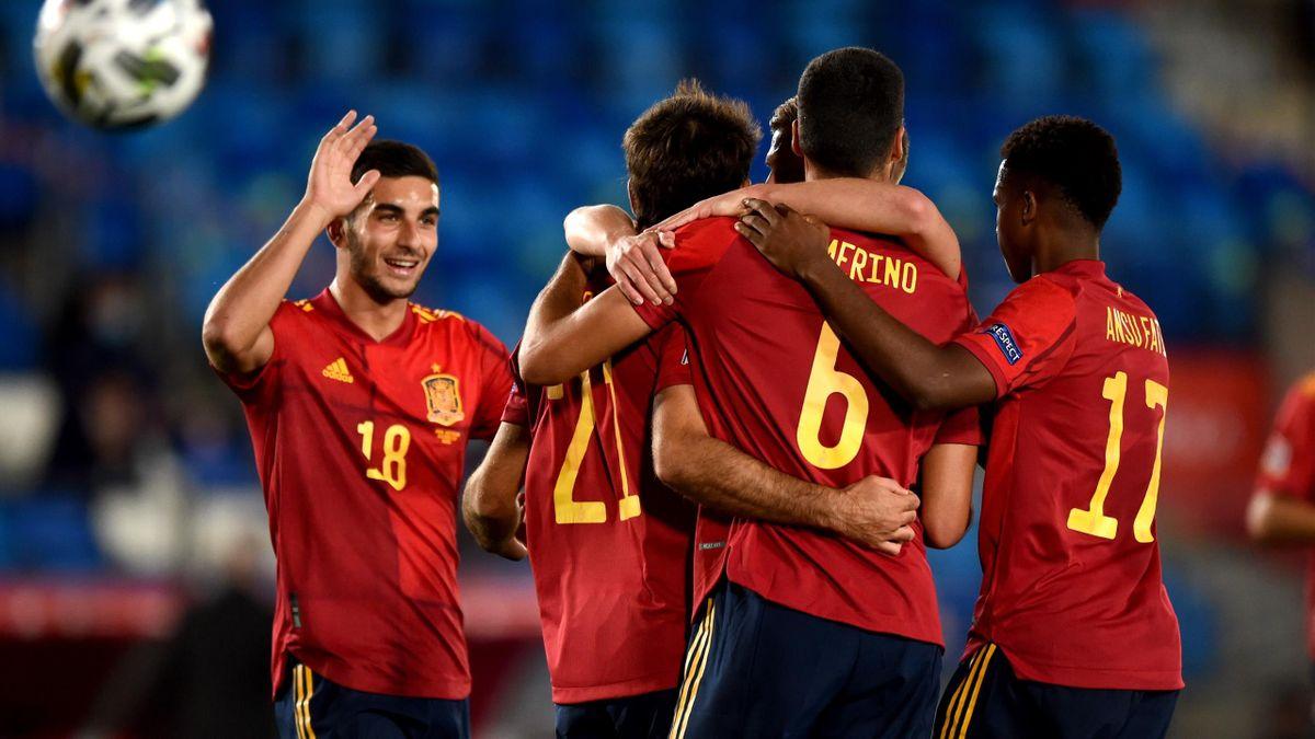 Spain celebrate their opening goal against Switzerland.