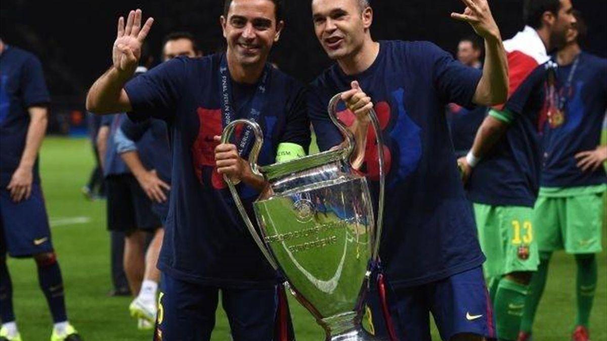Xavi_Iniesta_2015.jpg