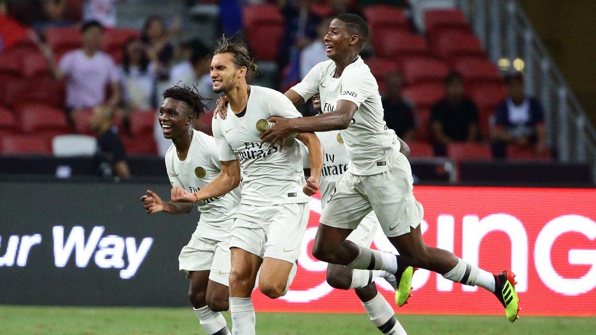 Virgiliu Postolachi of Paris Saint Germain reacts after scoring