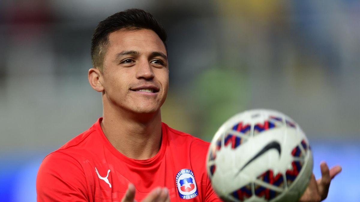 Chilean footballer Alexis Sanchez warms up before a friendly match against El Salvador