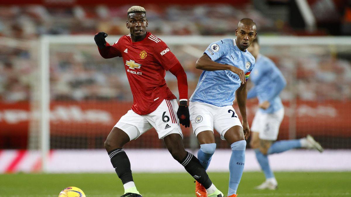 Paul Pogba of Manchester United and Fernandinho of Manchester City battle