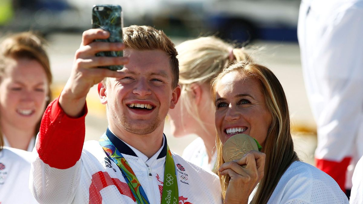 Team GB athlete Adam Peaty (L) poses for a photograph on his return home from the 2016 Rio Olympics, at Heathrow Airport in London, Britain August 23, 2016
