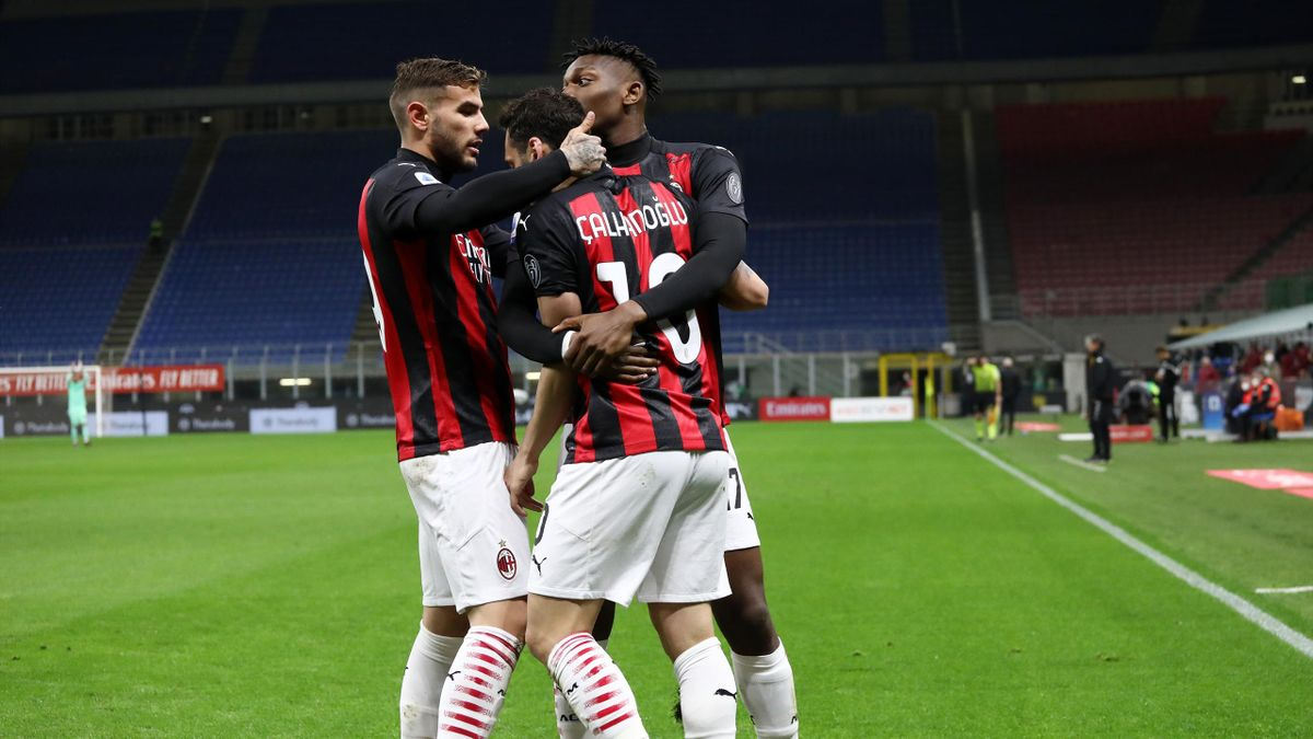 Hakan Calhanoglu of A.C. Milan celebrates with Theo Hernandez and Rafael Leao after scoring their side's first goal during the Serie A match between AC Milan and Benevento Calcio at Stadio Giuseppe Meazza on May 01, 2021 in Milan, Italy.