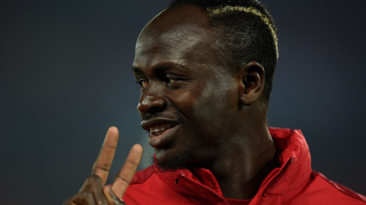 Liverpool's Senegalese striker Sadio Mane warms up ahead of the UEFA Champions League group E football match between Liverpool and RC Genk at Anfield in Liverpool, north west England on November 5, 2019. (Photo by Oli SCARFF / AFP) (Photo by OLI SCARFF/AF
