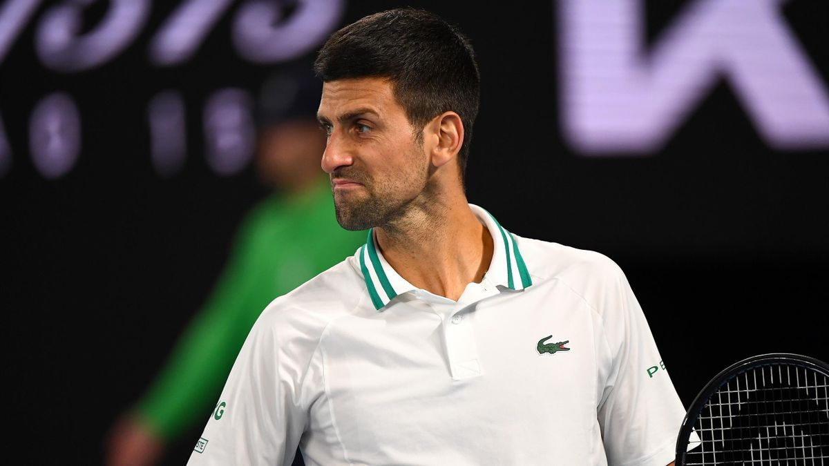Serbia's Novak Djokovic reacts on a point against Canada's Milos Raonic during their men's singles match on day seven of the Australian Open tennis tournament in Melbourne