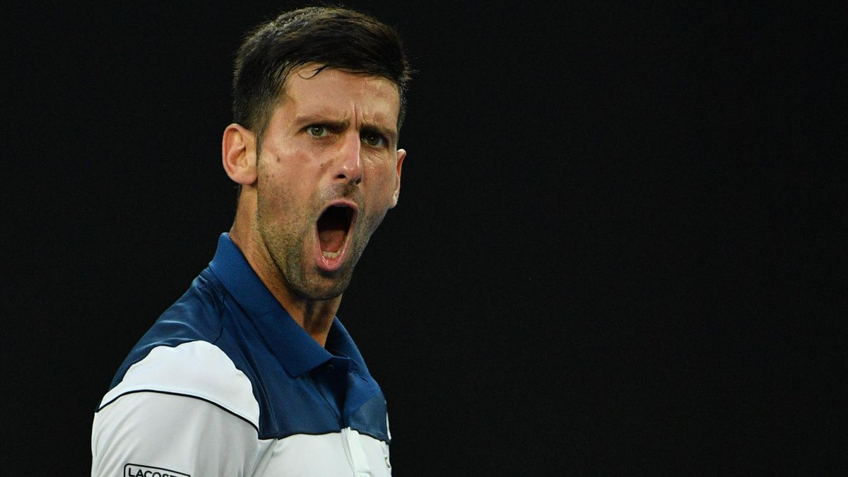 Serbia's Novak Djokovic shouts after a point against South Korea's Hyeon Chung during their men's singles fourth round match on day eight of the Australian Open tennis tournament in Melbourne on January 22, 2018.