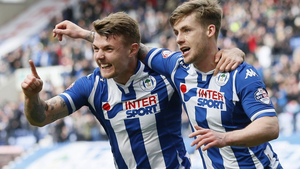 Wigan Athletic's Conor McAleny celebrates scoring their first goal.
