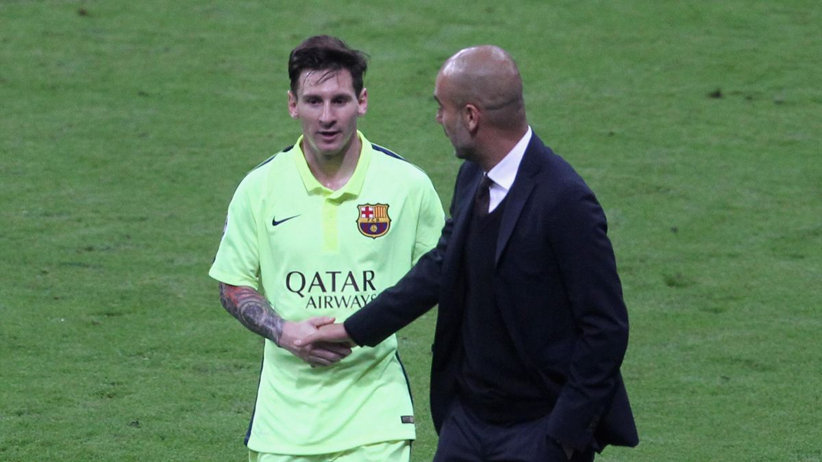 Team coach Josep Guardiola (R) of Bayern Muenchen shakes hands with Lionel Messi of FC Barcelona