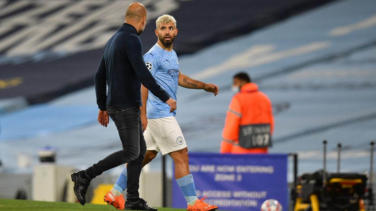 Sergio Aguero of Manchester City talks to Pep Guardiola, Manager of Manchester City as he leaves the pitch during the UEFA Champions League Group C stage match between Manchester City and FC Porto at Etihad Stadium on October 21, 2020 in Manchester, Engla