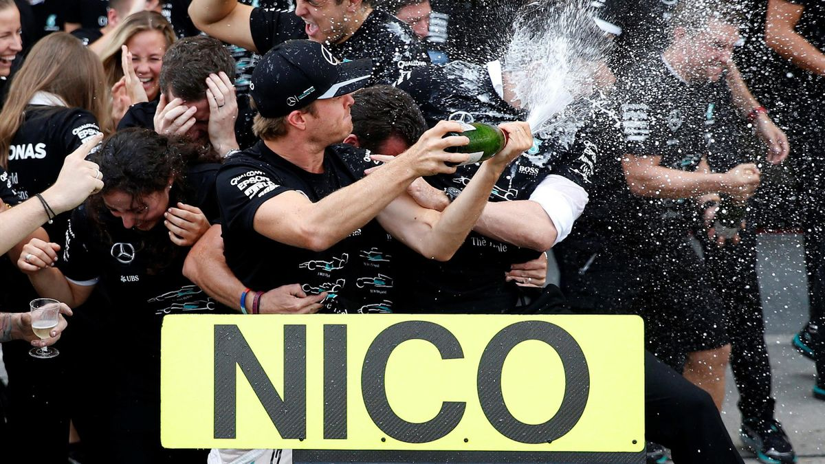 Mercedes' driver Nico Rosberg of Germany celebrates with team members after they won the Constructors' Championship title for the 2016 season after the race.