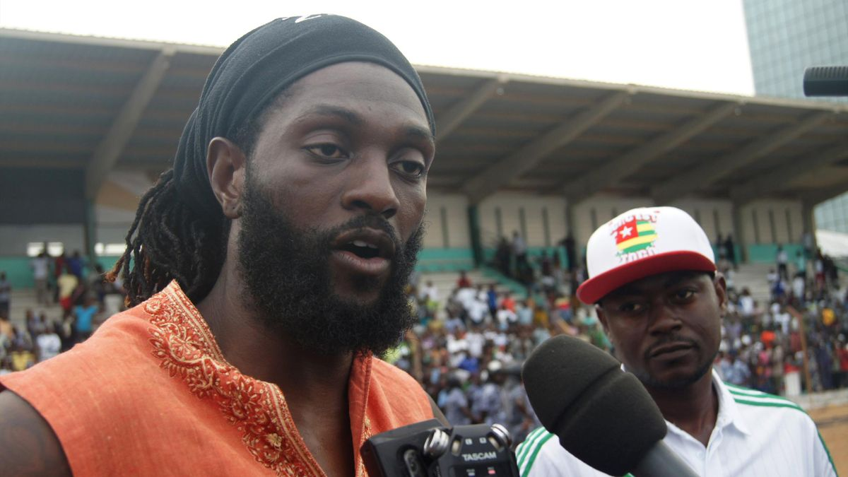 Togo national football team skipper Emmanuel Adebayor speaks during an exhibition match to mourn former coach in Lome on June 19, 2016