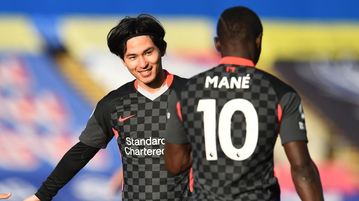 Takumi Minamino of Liverpool scores the first goal and celebrates