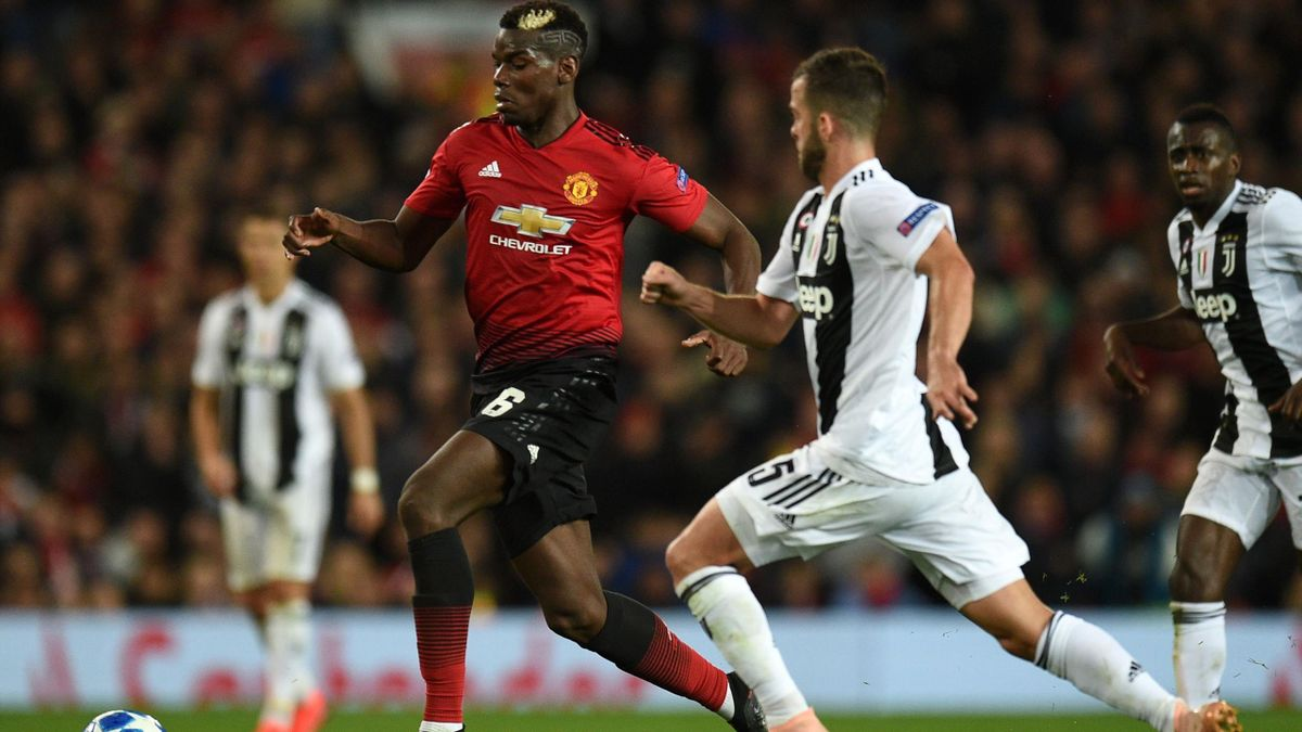 Manchester United's French midfielder Paul Pogba (L) vies with Juventus' Bosnian midfielder Miralem Pjanic (R) during the Champions League group H football match between Manchester United and Juventus at Old Trafford in Manchester, north west England, on