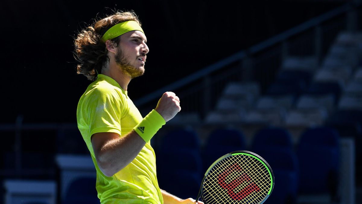 Greece's Stefanos Tsitsipas reacts after a point against Sweden's Mikael Ymer during their men's singles match on day six of the Australian Open tennis tournament in Melbourne