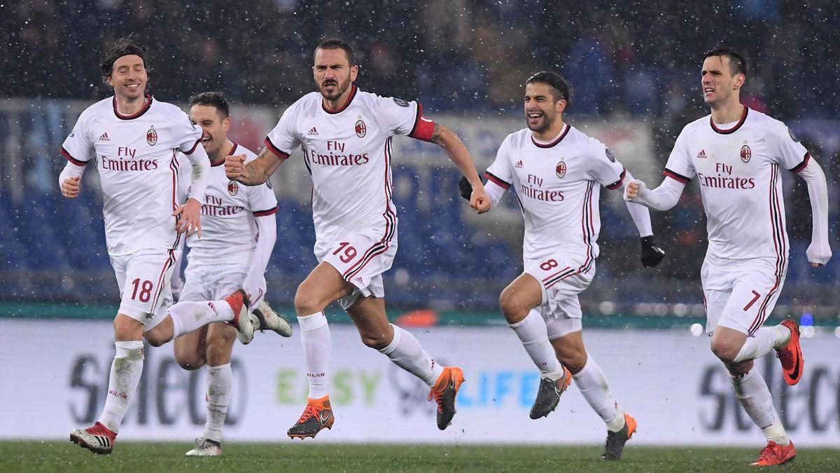 AC Milan's Leonardo Bonucci and team mates celebrate after winning the penalty shootout against Lazio