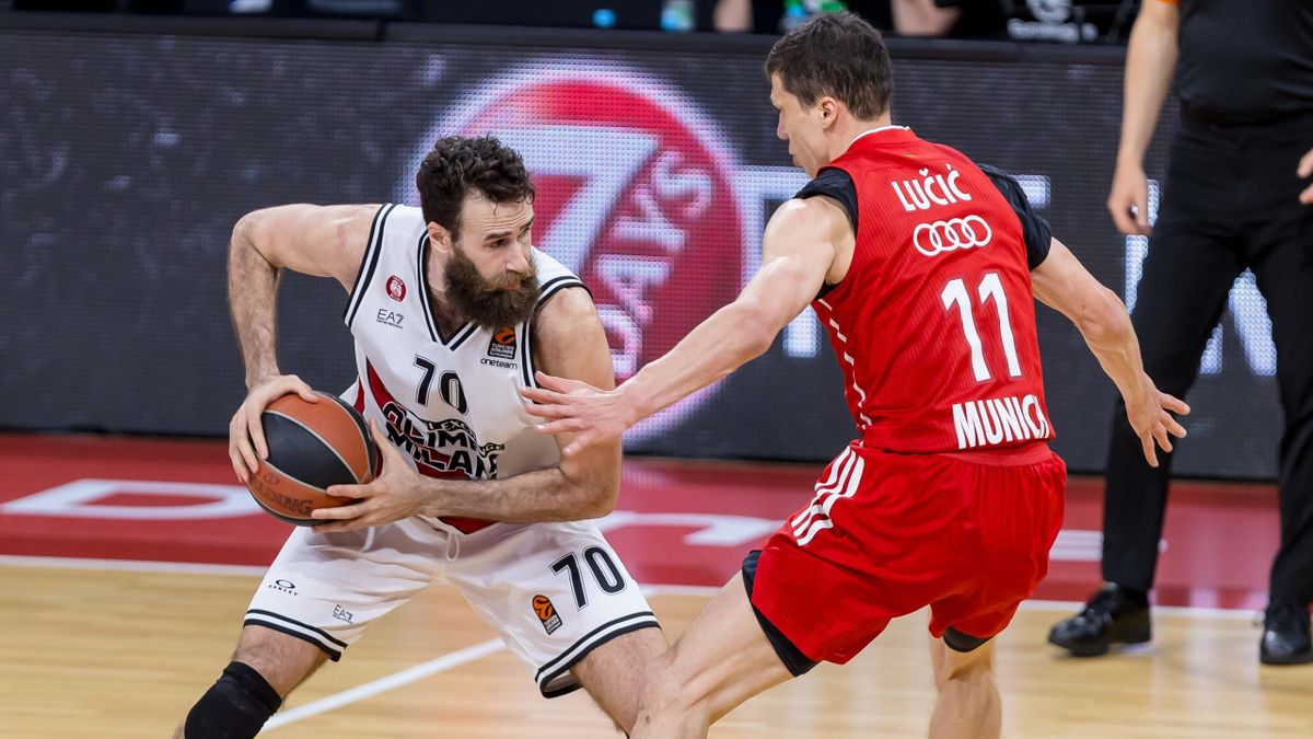 Luigi Datome of AX Armani Exchange Milan and Vladimir Lucic of FC Bayern Basketball battle for the ball during the 2020/2021 Turkish Airlines Euroleague Play Off Game 4 between FC Bayern Munich and AX Armani Exchange Milan at Audi Dome on April 30, 2021 i
