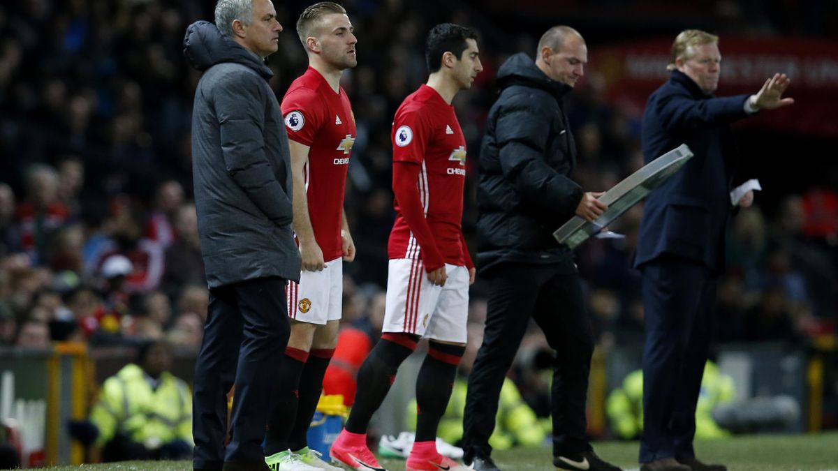 Manchester United's Luke Shaw and Henrikh Mkhitaryan wait to come on as substitutes as manager Jose Mourinho looks on