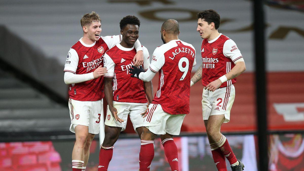 Bukayo Saka of Arsenal celebrates scoring their 3rd goal during the Premier League match between Arsenal and Chelsea at Emirates Stadium on December 26, 2020 in London, United Kingdom.