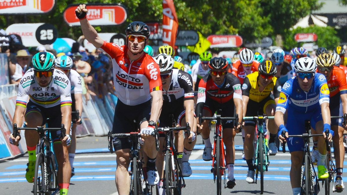 Germany's Andre Greipel (C-red jersey) from team Lotto Soudal celebrates as he crosses the finish line first on day one of the Tour Down Under cycling race in Lyndoch, a northern suburb of Adelaide on January 16, 2018.