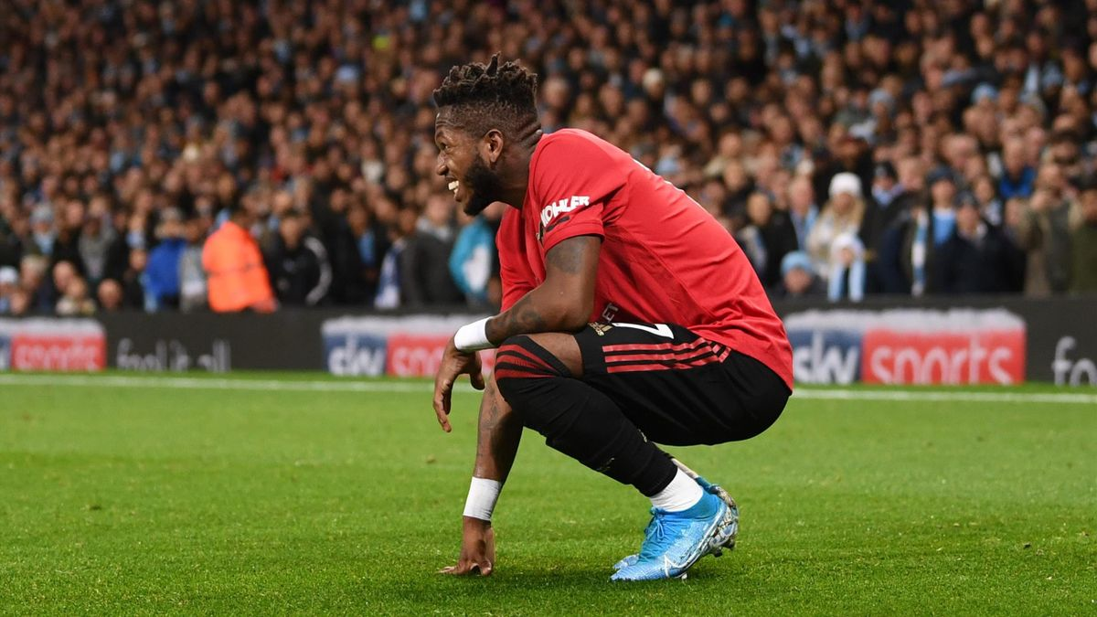 MANCHESTER, ENGLAND - DECEMBER 07: Fred of Manchester United reacts after being hit by a lighter thrown from the crowd during the Premier League match between Manchester City and Manchester United at Etihad Stadium on December 07, 2019 in Manchester, Unit