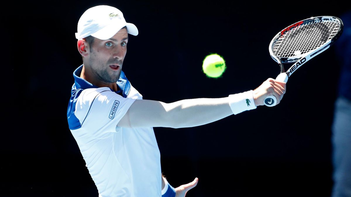 Novak Djokovic of Serbia plays a backhand in his second round match against Gael Monfils of France on day four of the 2018 Australian Open at Melbourne Park on January 18