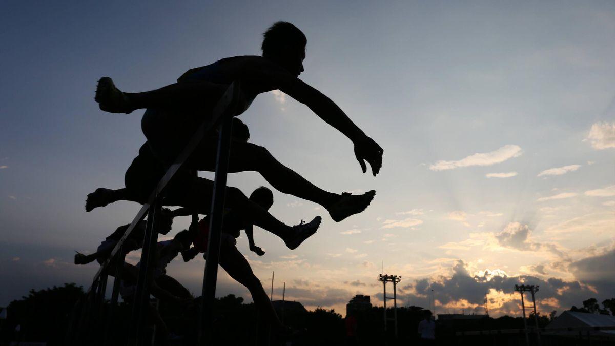 Hurdles athletes in action