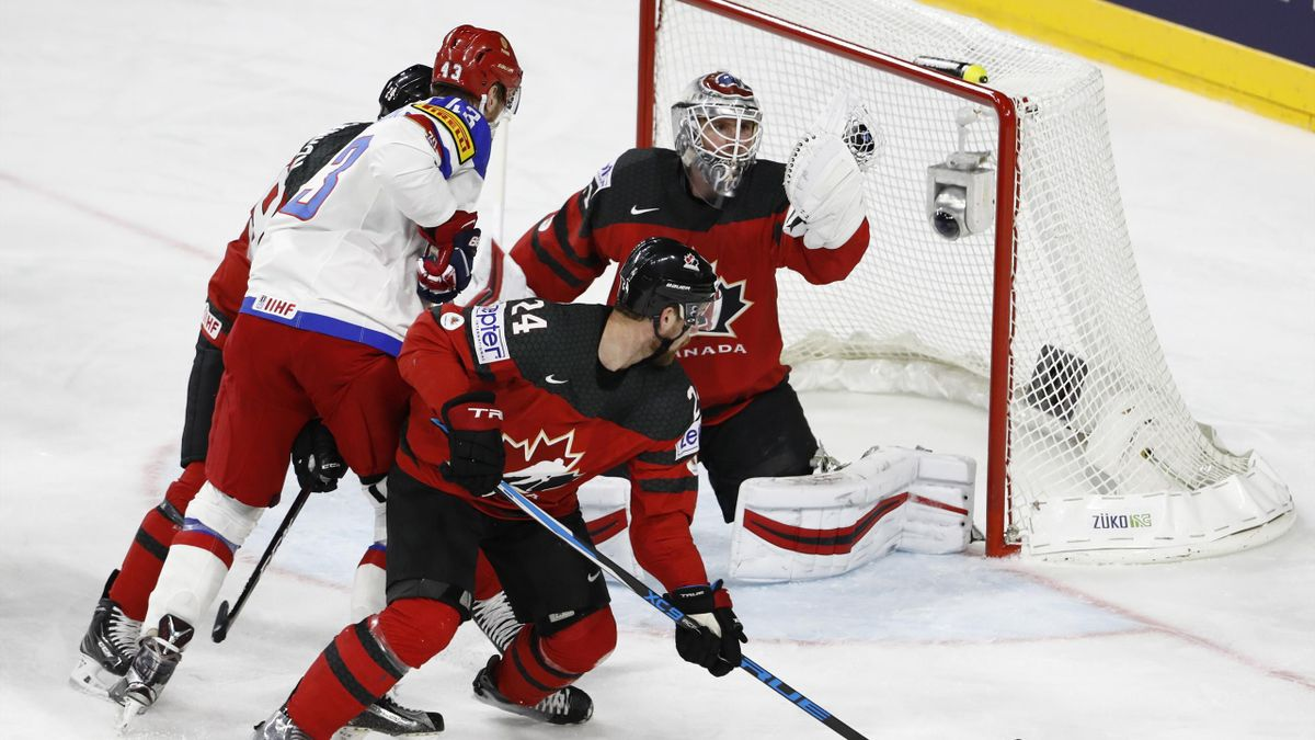 Canada's goalkeeper Calvin Pickard (R) makes a save during the IIHF Men's World Championship Ice Hockey semi-final match between Canada and Russia