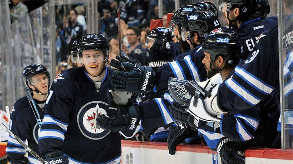 Andrew Copp #51 of the Winnipeg Jets celebrates with team-mates
