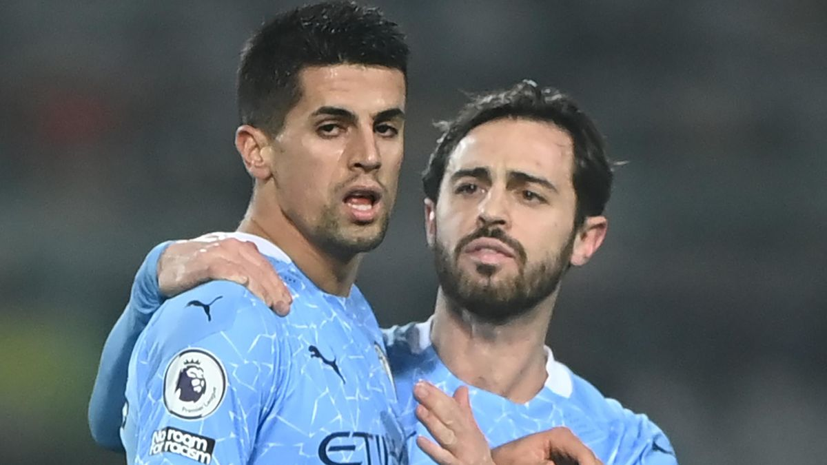 Joao Cancelo (L) scored for Manchester City