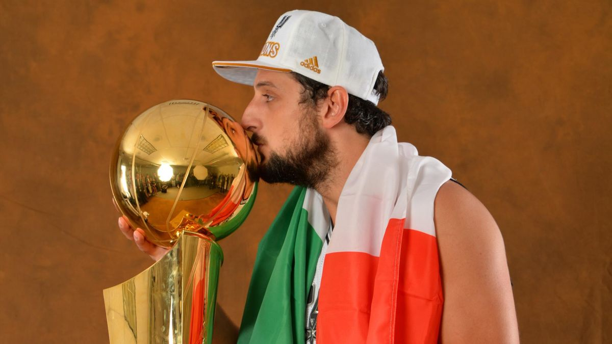 Marco Belinelli of the San Antonio Spurs poses for a portrait with the Larry O'Brien Trophy after defeating the Miami Heat in Game Five of the 2014 NBA Finals on June 15, 2014 at AT&T Center in San Antonio, Texas