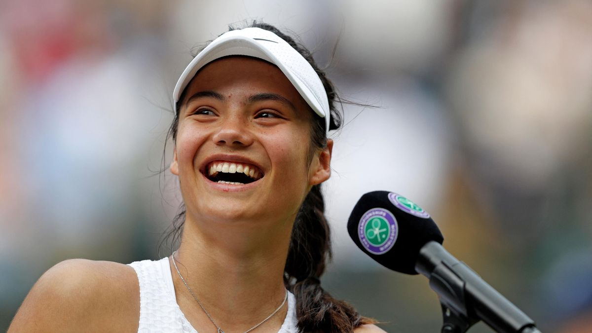 Britain's Emma Raducanu reacts as she gives a media interview after winning against Romania's Sorana Cirstea during their women's singles third round match on the sixth day of the 2021 Wimbledon Championships at The All England Tennis Club