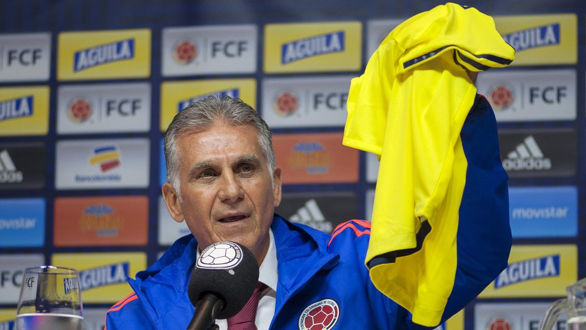 Colombia's national football team new head coach, Portuguese Carlos Queiroz, holds up a Colombian jersey as he speaks during a press conference in Bogota on February 7, 2019.