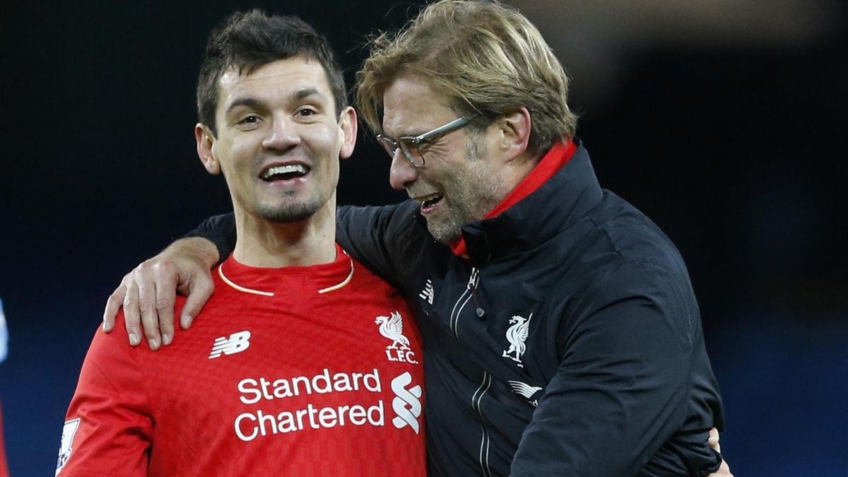 Liverpool manager Juergen Klopp celebrates with Dejan Lovren after the game