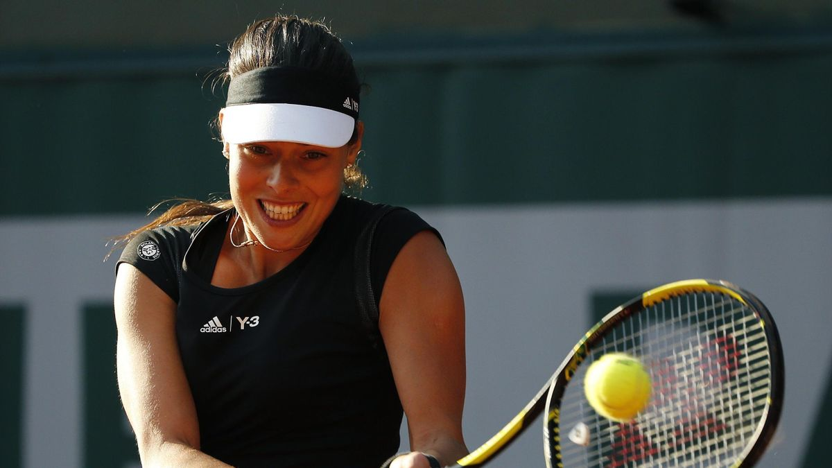 Ana Ivanovic of Serbia plays a shot to Misaki Doi of Japan during their the women's singles match at the French Open tennis tournament at the Roland Garros stadium