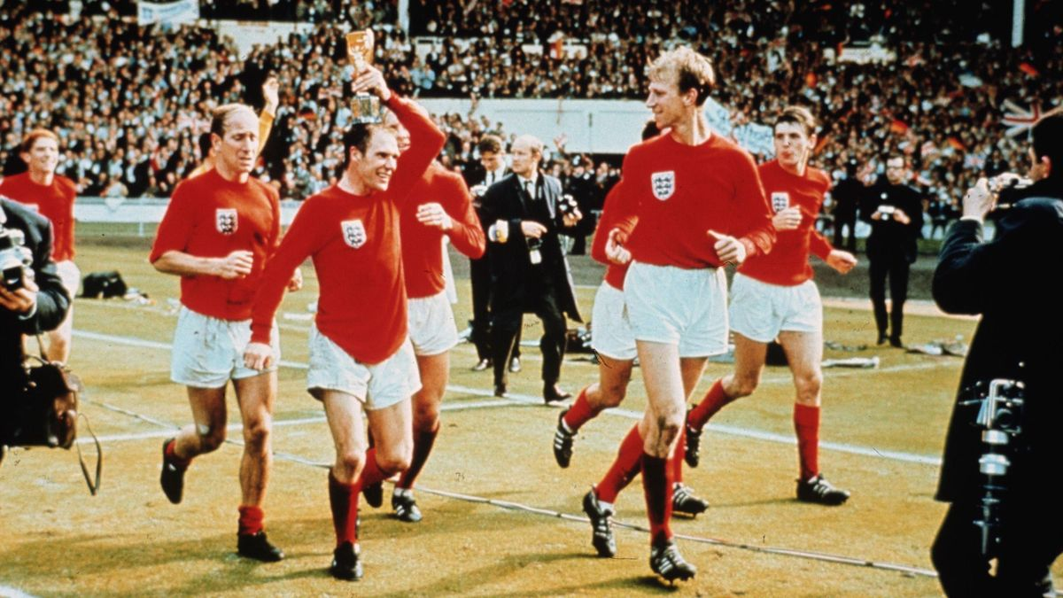 Ray Wilson (holding the trophy) and Charlton brothers Sir Bobby and Jack - all three were diagnosed with dementia