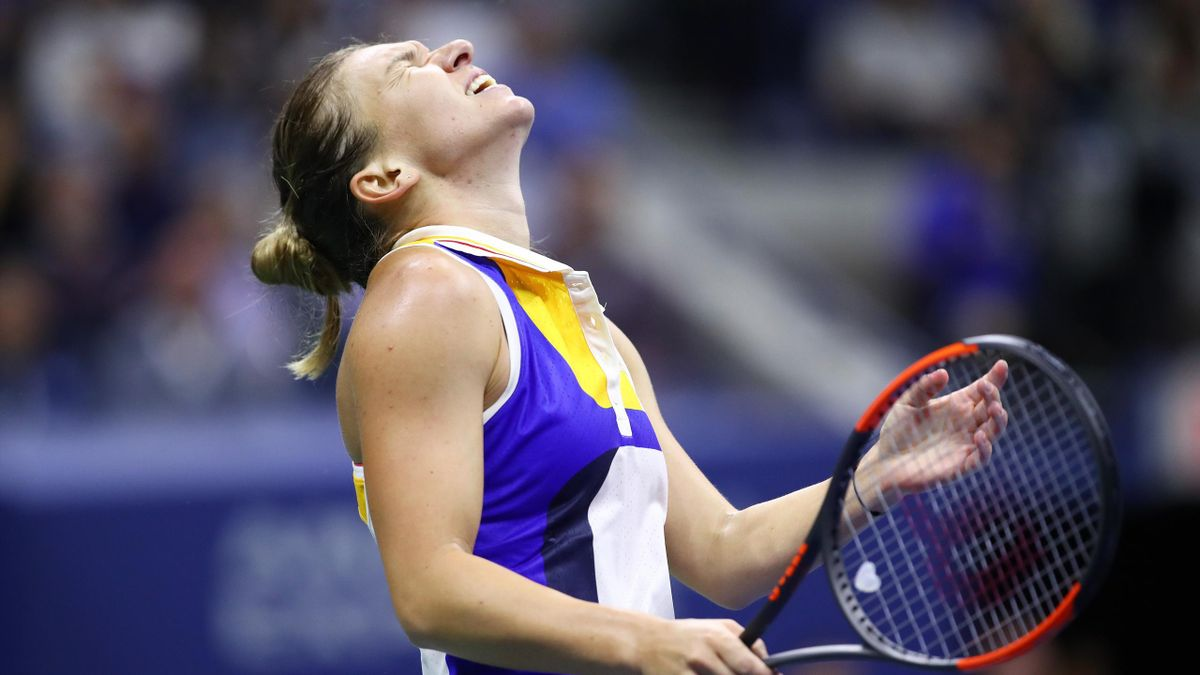 Simona Halep of Romania reacts in the her first round Women's Singles match loss to Maria Sharapova of Russia on Day One of the 2017 US Open
