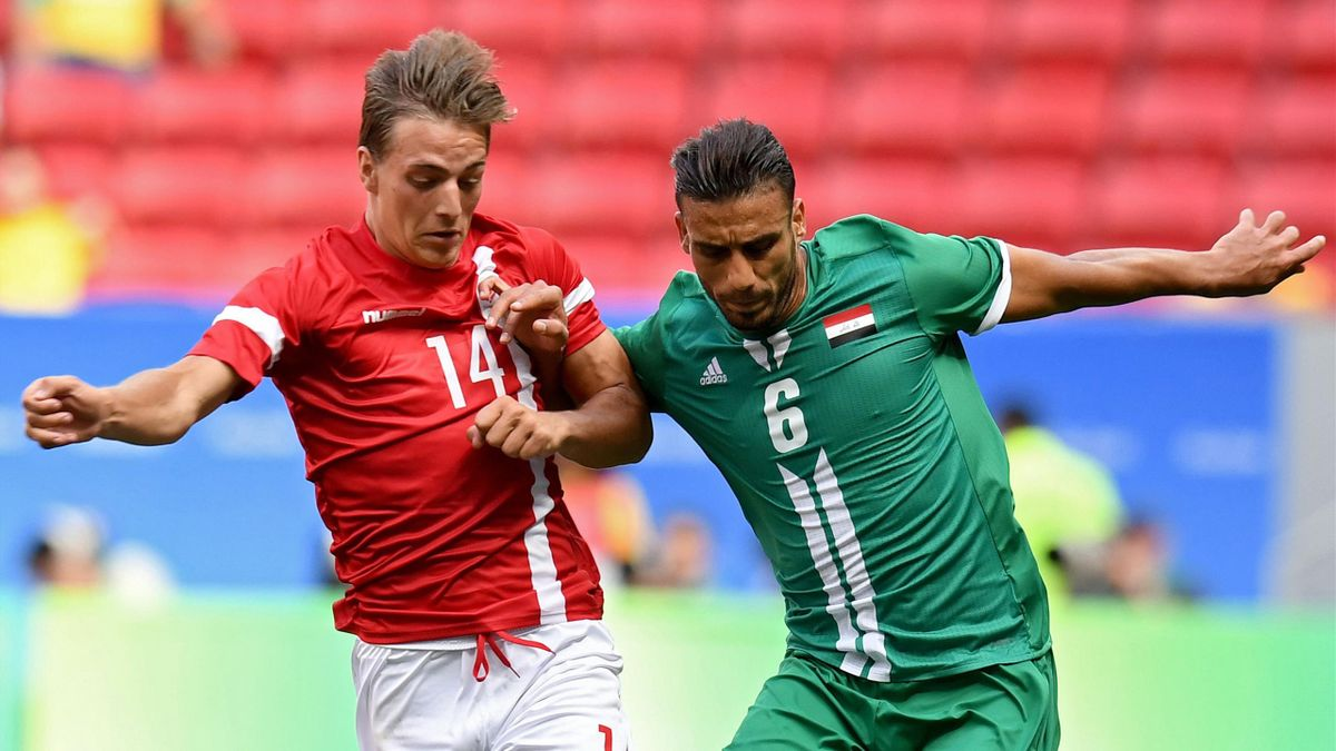 raq player Ali Adnan (R) is marked by Denmark player Casper Nielsen during their Rio 2016 Olympic Games First Round Group A men's football match Denmark vs Iraq, at the Mane Garrincha Stadium in Brasilia on August 4, 2016