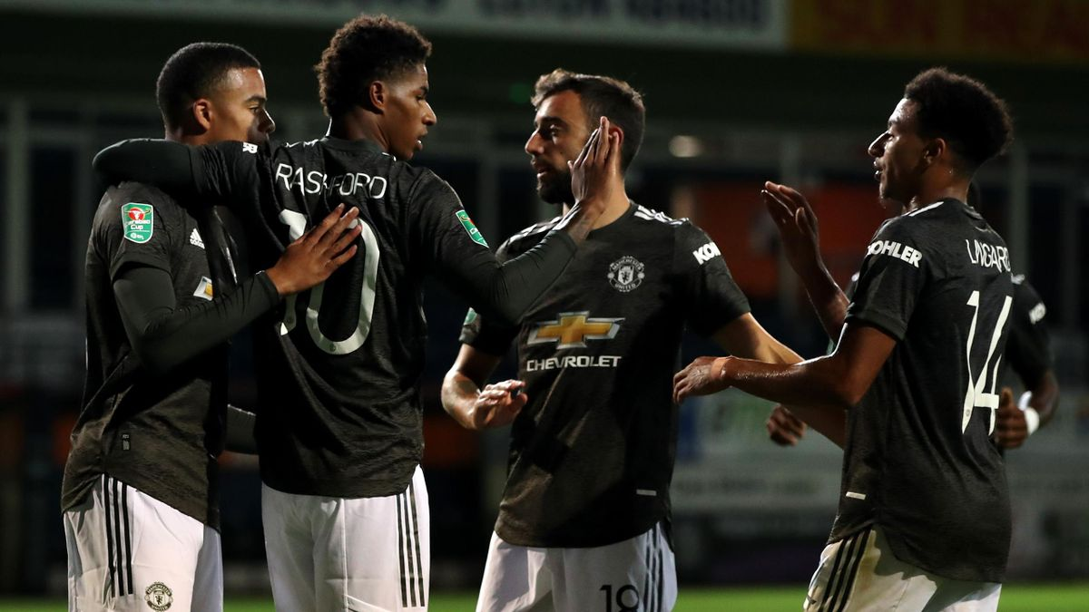 Marcus Rashford (2L) celebrates scoring his team's second goal during the English League Cup third round football match between Luton Town and Manchester United