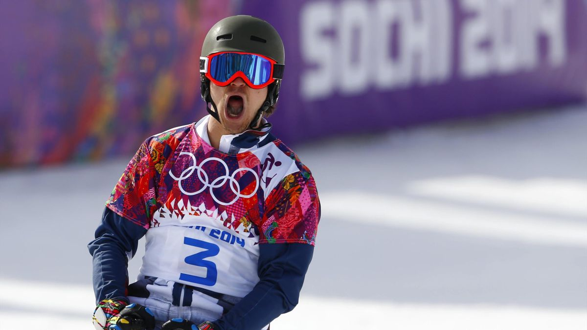 Russia's Vic Wild reacts during the men's parallel slalom snowboard finals at the 2014 Sochi Winter Olympic Games in Rosa Khutor February 22, 2014 (Reuters)
