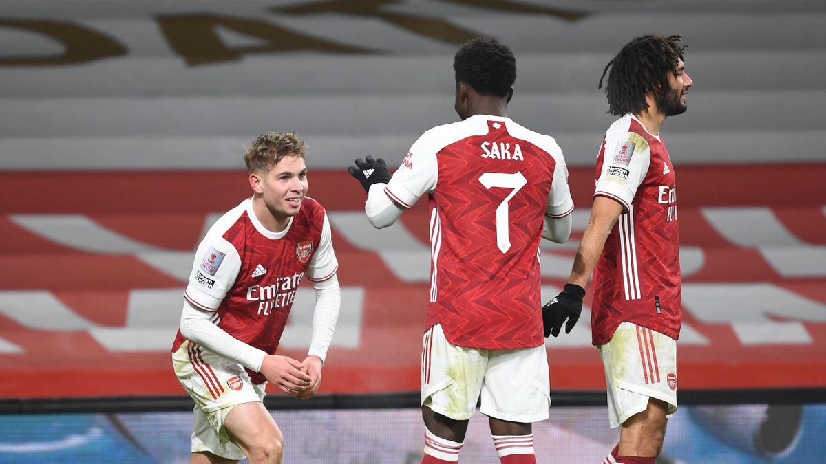 Emile Smith Rowe celebrates scoring the 1st Arsenal goal with (R) Bukayo Saka during the FA Cup Third Round match between Arsenal and Newcastle United at Emirates Stadium on January 09, 2021 in London, England.