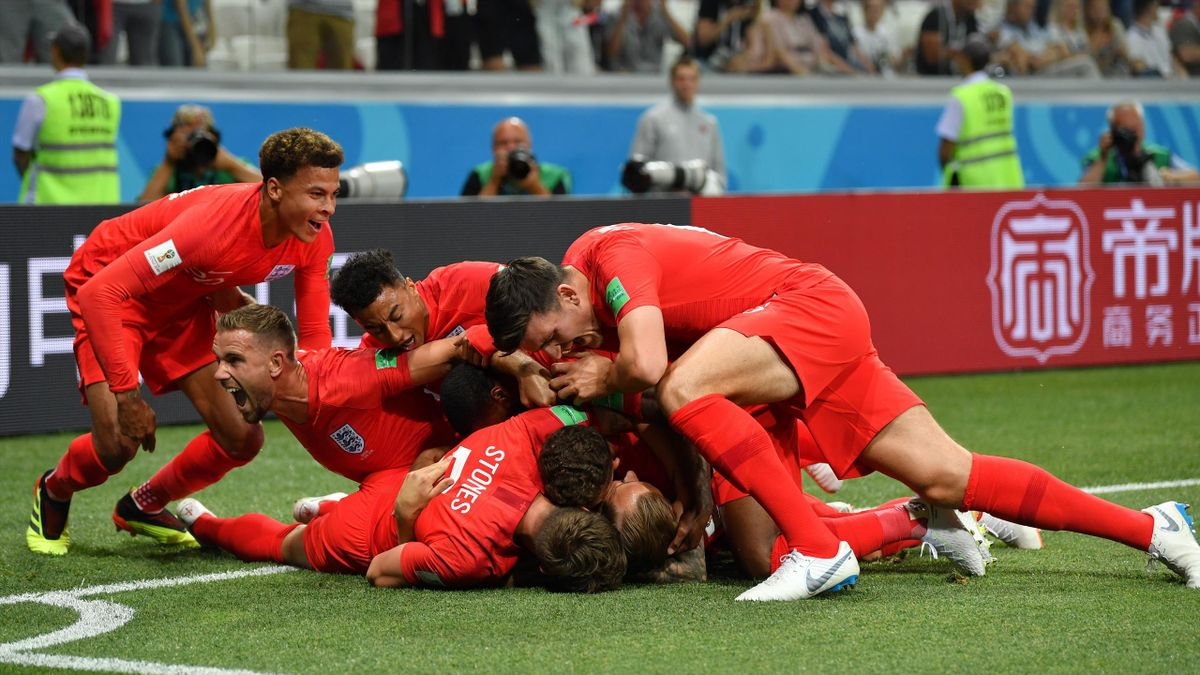 Harry Kane of England celebrates after scoring his team's first goal with team mates during the 2018 FIFA World Cup Russia group G match between Tunisia and England at Volgograd Arena on June 18, 2018 in Volgograd.