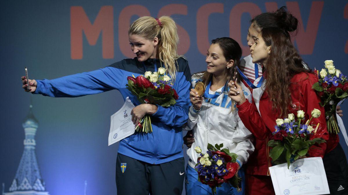 Italy's Rossella Fiamingo on the podium (PA)
