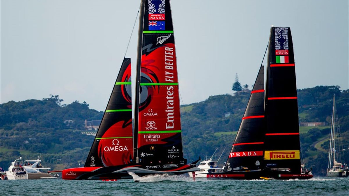 Emirates Team New Zealand (L) competes against Luna Rossa Prada Pirelli Team during the America's Cup Race 8 on Auckland Harbour on March 15, 2021 in Auckland