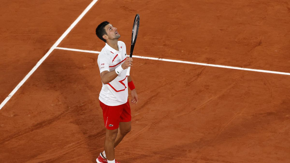 Novak Djokovic of Serbia celebrates victory following his Men's Singles first round match against Mikael Ymer of Sweden on day three of the 2020 French Open at Roland Garros