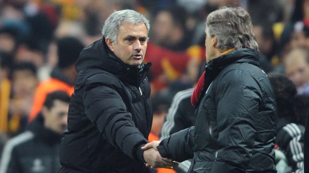 Chelsea manager Jose Mourinho and Galatasaray's Roberto Mancini shake hands (AFP)